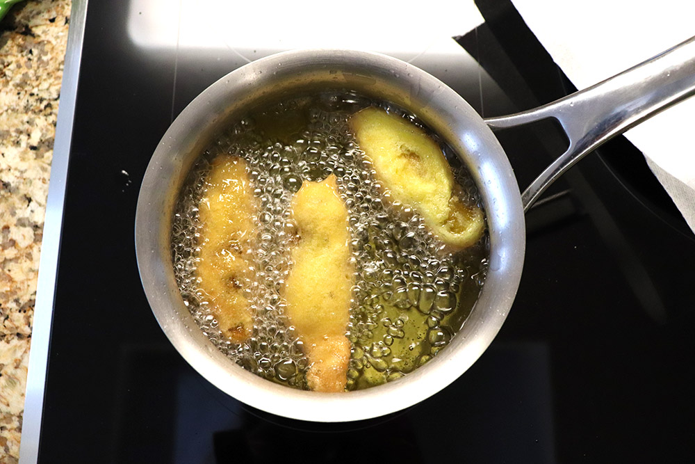 frying chile rellenos