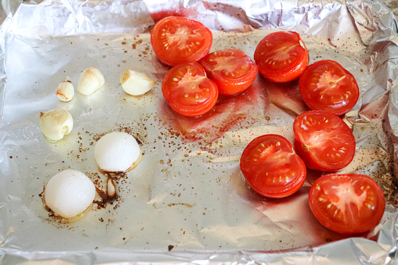 Roasted tomatoes, onion, and garlic in olive oil, salt and pepper